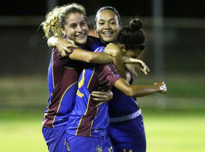 Viviana Fiol y Ashlery Rivera celebran durante el partido de la Criollas FC ante las Águilas de Añasco. Suministrada JPG Media
